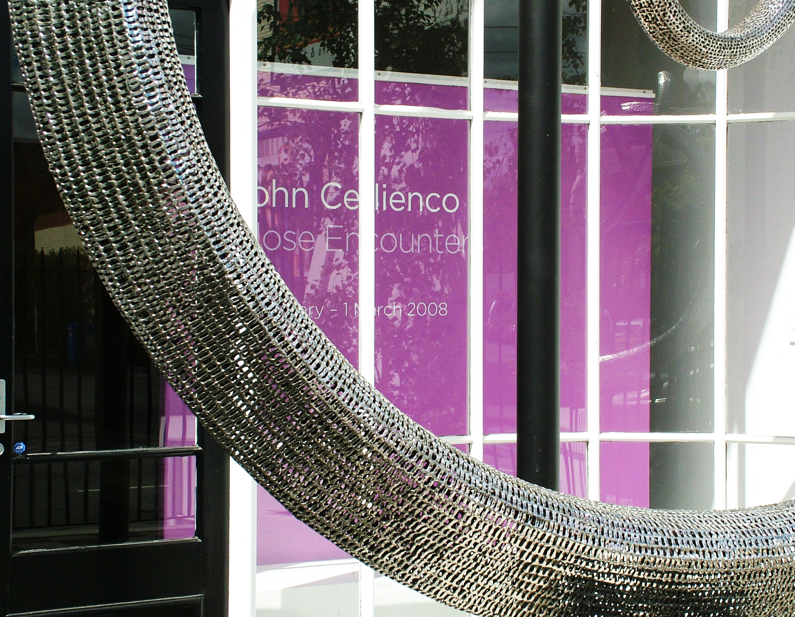 Front window of Mossgreen Gallery entrance advertising Çlose Encounters'2008 exhibition